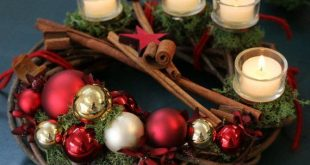 """Advent Wreath """"Kugli"""" of dark wood, red balls and small elements of artificial flowers and moss"""