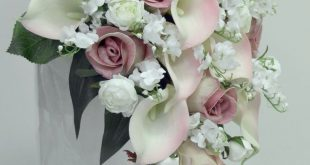 I think the lillies interspersed really work well with the roses. Starting to th...